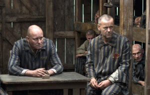 MASTERPIECE CONTEMPORARY God On Trial Sunday, November 9, 2008 at 9pm ET on PBS Who is to blame for the greatest of all crimes? Facing extermination at Auschwitz, a group of prisoners solemnly weighs the case against the Lord God, in God on Trial, airing on MASTERPIECE CONTEMPORARY. Shown (left to right): Stephen Dillane as Schmidt, Stellan Skarsgard as Baumgarten, and Rupert Graves as Mordechai. (c) Neil Davidson/Hat Trick Productions for MASTERPIECE